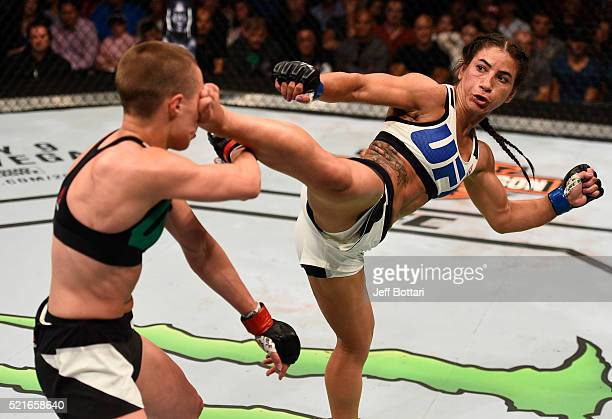 Tecia Torres kicks Rose Namajunas in their women's strawweight bout during the UFC Fight Night event at Amalie Arena on April 16 2016 in Tampa Florida