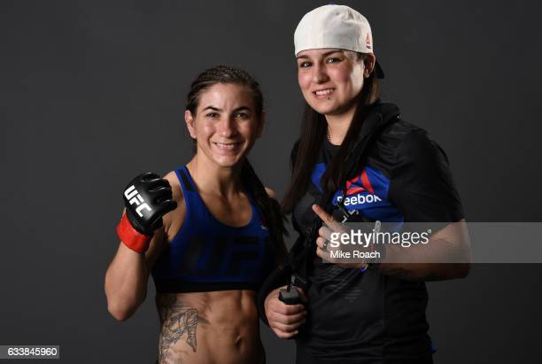 Tecia Torres poses for a picture backstage with Raquel Pennington during the UFC Fight Night event at the Toyota Center on February 4 2017 in Houston...