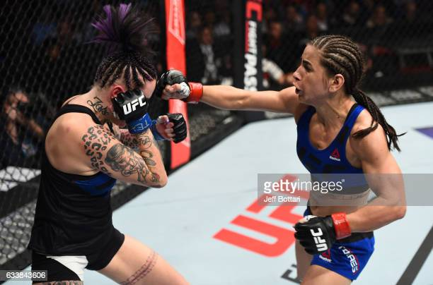 Tecia Torres punches Bec Rawlings of Australia in their women's strawweight bout during the UFC Fight Night event at the Toyota Center on February 4...
