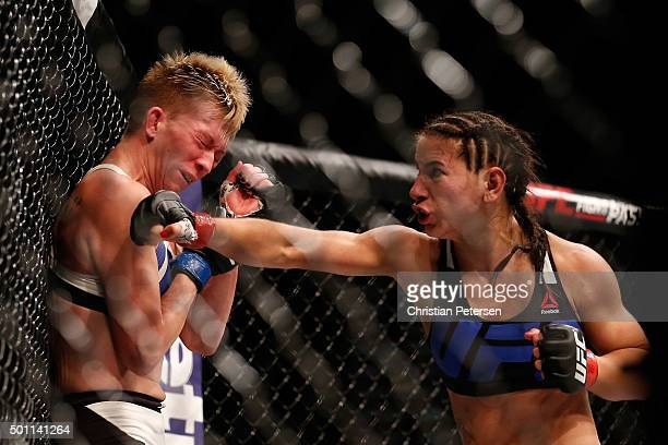 Tecia Torres punches Jocelyn JonesLybarger in their women's strawweight bout during the UFC 194 event inside MGM Grand Garden Arena on December 12...