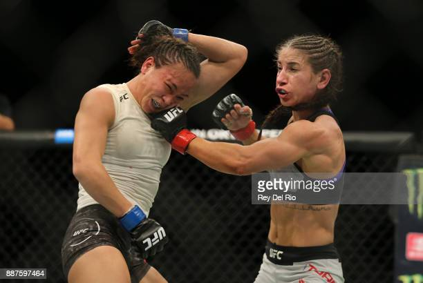 Tecia Torres punches Michelle Waterson during the UFC 218 event at Little Caesars Arena on December 2 2017 in Detroit Michigan