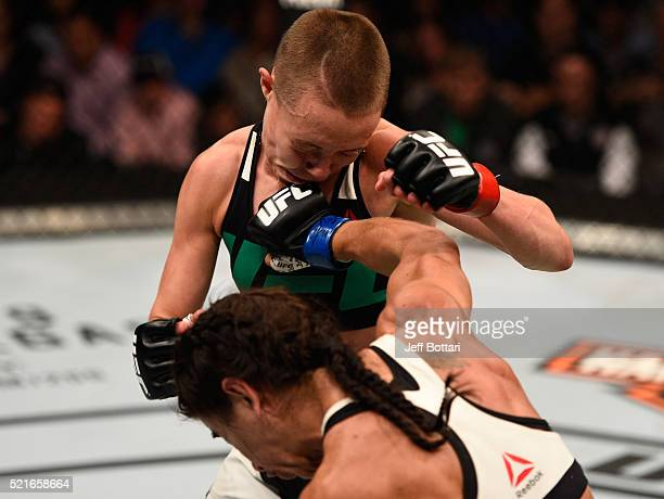 Tecia Torres punches Rose Namajunas in their women's strawweight bout during the UFC Fight Night event at Amalie Arena on April 16 2016 in Tampa...