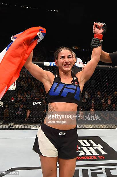 Tecia Torres reacts to her victory over Jocelyn JonesLybarger in their women's strawweight bout during the UFC 194 event inside MGM Grand Garden...