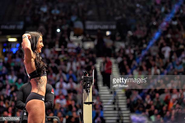 Tecia Torres steps on the scale during the UFC 194 Weighin event at the MGM Grand Garden Arena on December 11 2015 in Las Vegas Nevada