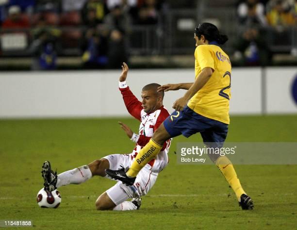 Tecos' Emanuel Villa makes a sliding tackle on America's Ismael Rodriguez during InterLiga 2007 action between America and UAG TECOS Jan 4 2007 at...