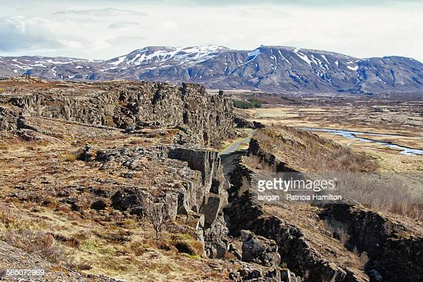 tectonic plates pulling apart at a rift - tectonic stock photos and pictures
