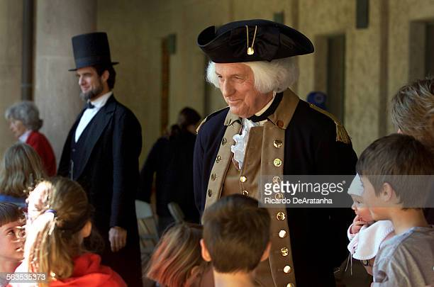 Ted Alexander as former President George Washington front and John Kendall as former President Abraham Lincoln greeting people at the Ronald Reagan...