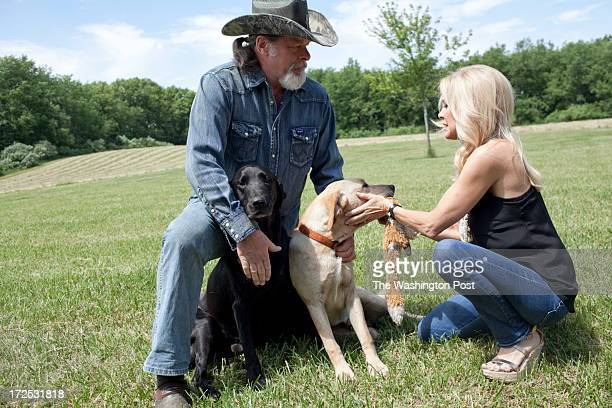 Ted and his wife Shemane Nugent play with the dogs and go for a walk on their 1200 acre ranch in Concord Michigan on June 6 2013 Ted said when he was...