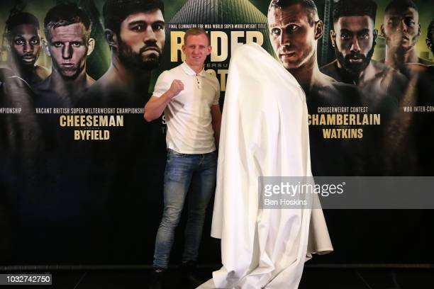 Ted Cheeseman pose for a photo with someone dressed as Asinia Byfield aka The Ghost during a press conference with boxing promoter Eddie Hearn at The...