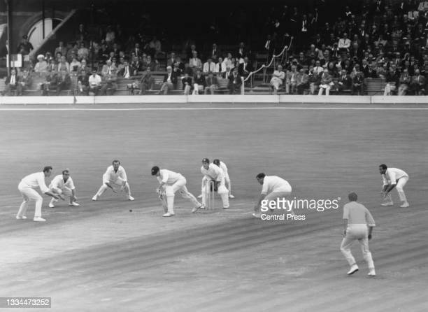 Ted Dexter, John Edrich, Tom Graveney, wicket-keeper Alan Knott, Colin Cowdrey, Colin Milburn and Basil D'Oliveira of England surround Ashley Mallett...