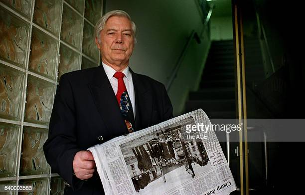 Ted Drane with a copy of the newspaper article about a visit by families of the Dunblane shooting victims in Scotland to Tasmania to meet with...