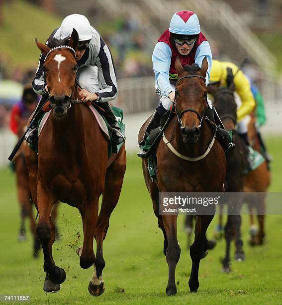 Ted Durcan and Light Shift get the better of the Jamie Spencer ridden Fashion Statement to land The Weatherbys Bank Cheshire Oaks Race run at Chester...
