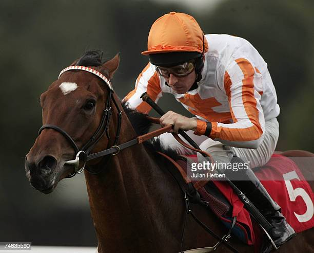 Ted Durcan pushes Sundae out to land The Fleming Russell Stent Handicap Stakes Race run at Sandown Racecourse on June 15 in Sandown, England.