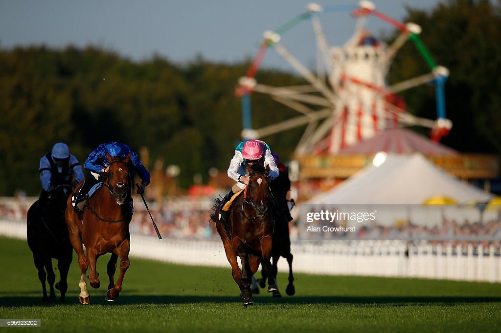 Ted Durcan riding Rostova (C, pink cap) win The breeders Backing Racing EBF Fillies' Stakes at Goodwood on August 26, 2016 in Chichester, England.