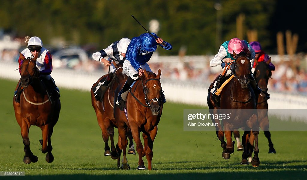 Ted Durcan riding Rostova (R, pink cap) win The breeders Backing Racing EBF Fillies' Stakes at Goodwood on August 26, 2016 in Chichester, England.