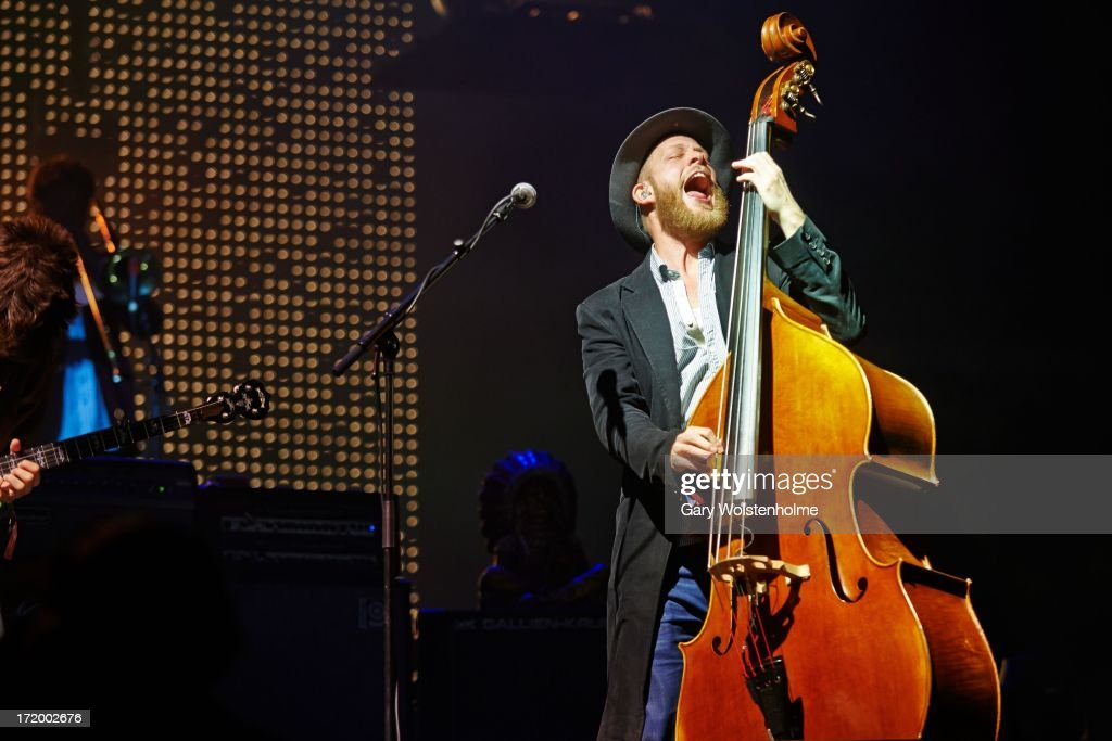 Ted Dwane of Mumford and Sons performs on stage on Day 4 of Glastonbury Festival at Worthy Farm on June 30, 2013 in Glastonbury, England.