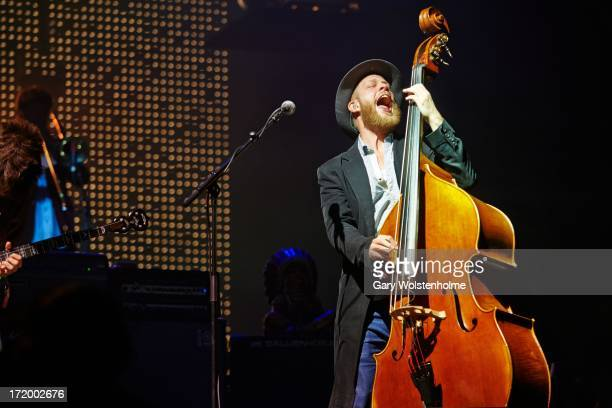 Ted Dwane of Mumford and Sons performs on stage on Day 4 of Glastonbury Festival at Worthy Farm on June 30 2013 in Glastonbury England