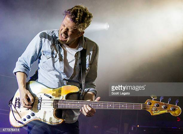 Ted Dwane of Mumford Sons performs during their Gentlemen on the Road Tour at DTE Energy Music Theater on June 16 2015 in Clarkston Michigan