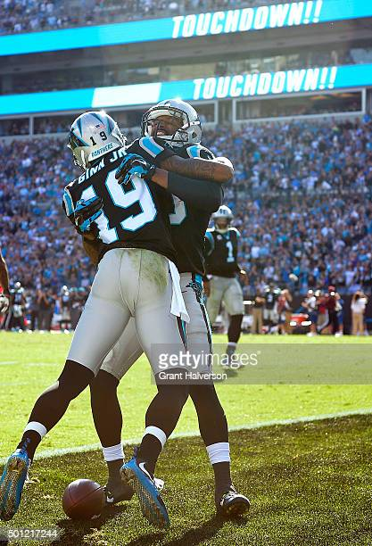 Ted Ginn celebrates with teammate Corey Brown of the Carolina Panthers after scoring a touchdown against the Atlanta Falcons during their game at...