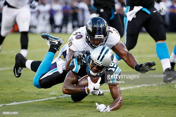 Ted Ginn Jr #19 of the Carolina Panthers gets tackled from behind by Albert McClellan of the Baltimore Ravens in the first quarter of a preseason NFL...