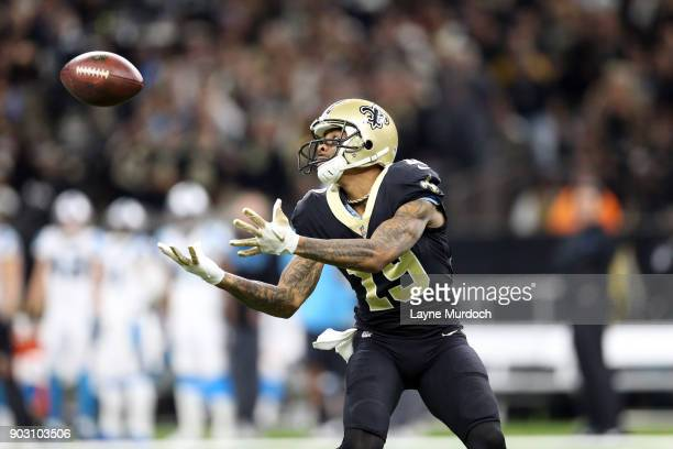 Ted Ginn Jr #19 of the New Orleans Saints catches a touchdown catch against the Carolina Panthers during the first half of the NFC Wild Card playoff...
