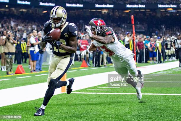 Ted Ginn Jr #19 of the New Orleans Saints catches a touchdown pass over Carlton Davis III of the Tampa Bay Buccaneers at MercedesBenz Superdome on...