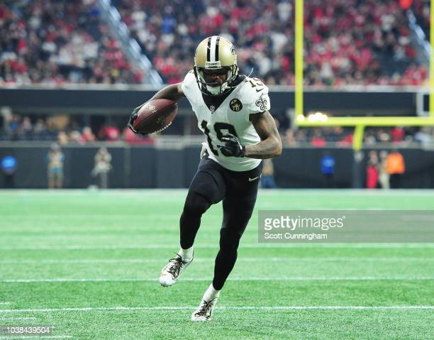 Ted Ginn Jr #19 of the New Orleans Saints runs with a catch for a first quarter touchdown against the Atlanta Falcons at MercedesBenz Stadium on...