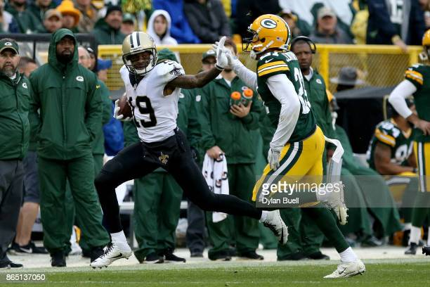 Ted Ginn Jr #19 of the New Orleans Saints runs with the ball while being chased by Ha Ha ClintonDix of the Green Bay Packers in the third quarter at...