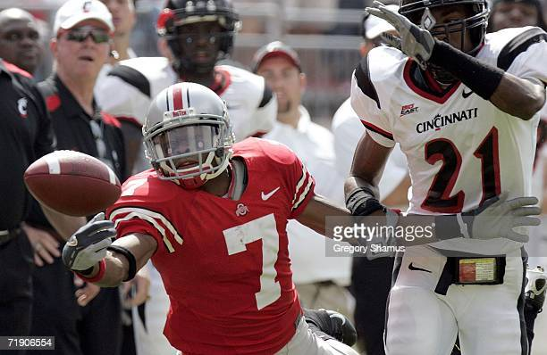 Ted Ginn Jr. #7 of the Ohio State Buckeyes can't pull in this first quarter pass in front of Anderson Russell of the Cincinnati Bearcats on September...