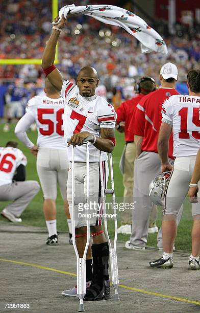 Ted Ginn Jr #7 of the Ohio State Buckeyes cheers on the sidelines in crutches after being injured in the first quarter of the 2007 Tostitos BCS...