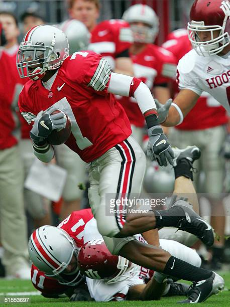 Ted Ginn Jr. #7 of the Ohio State University Buckeyes makes a 59-yard touchdown reception in front of Buster Larkins of the Indiana University...