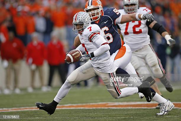 Ted Ginn Jr of Ohio State runs with a reception during action between the Ohio State Buckeyes and Illinois Fighting Illini at Memorial Stadium in...
