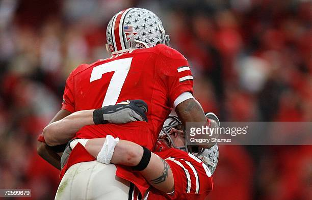 Ted Ginn Jr. Of the Ohio State Buckeyes celebrates his 39-yard touchdown with Rory Nicol in the second quarter against the Michigan Wolverines...