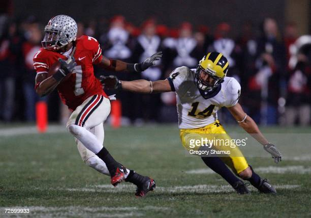 Ted Ginn Jr. Of the Ohio State Buckeyes in the second half runs for yards after the catch against Morgan Trent the Michigan Wolverines November 18,...