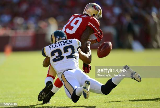 Ted Ginn Jr of the San Francisco 49ers returning a kickoff has the ball stripped away by Bradley Fletcher of the St Louis Rams during the first...