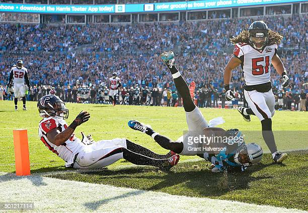 Ted Ginn of the Carolina Panther makes a touchdown catch against Ricardo Allen and Philip Wheeler of the Atlanta Falcons during the first quarter of...