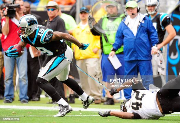 Ted Ginn of the Carolina Panthers breaks away from Isa AbdulQuddus of the New Orleans Saints during their game at Bank of America Stadium on December...