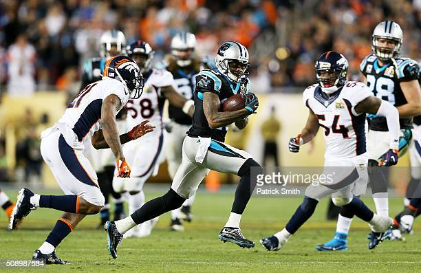 Ted Ginn of the Carolina Panthers runs after a catch against Aqib Talib of the Denver Broncos in the third quarter during Super Bowl 50 at Levi's...