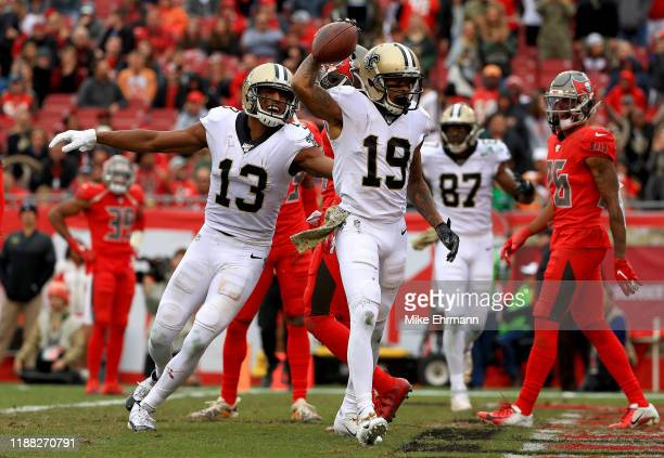 Ted Ginn of the New Orleans Saints and Michael Thomas celebrates a touchdown during a game against the Tampa Bay Buccaneers at Raymond James Stadium...