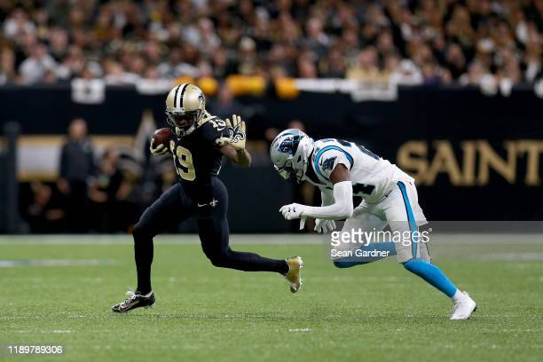 Ted Ginn of the New Orleans Saints breaks a tackle against James Bradberry of the Carolina Panthers during the first quarter in the game at Mercedes...