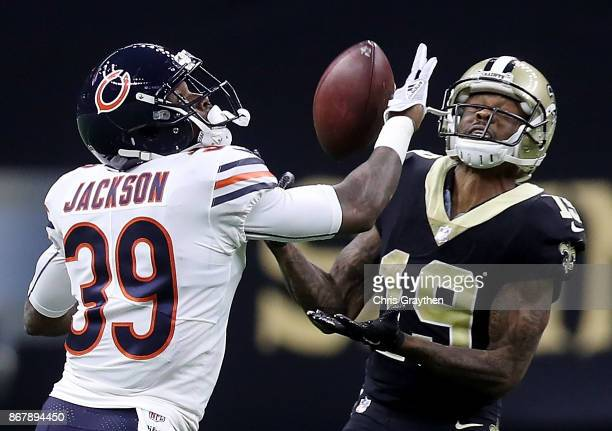 Ted Ginn of the New Orleans Saints catches a pass as he is defended by Eddie Jackson of the Chicago Bears during the fourth quarter at the...
