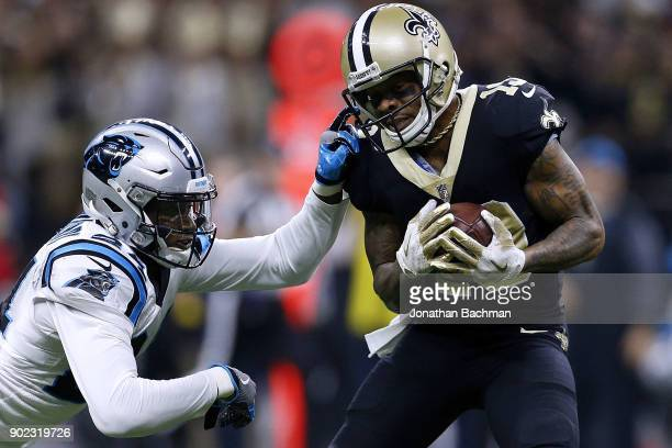 Ted Ginn of the New Orleans Saints catches the ball for a touchdown as James Bradberry of the Carolina Panthers defends during the first half of the...