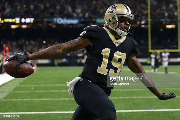 Ted Ginn of the New Orleans Saints celebrates a touchdown during the first half of a game against the Atlanta Falcons at the MercedesBenz Superdome...