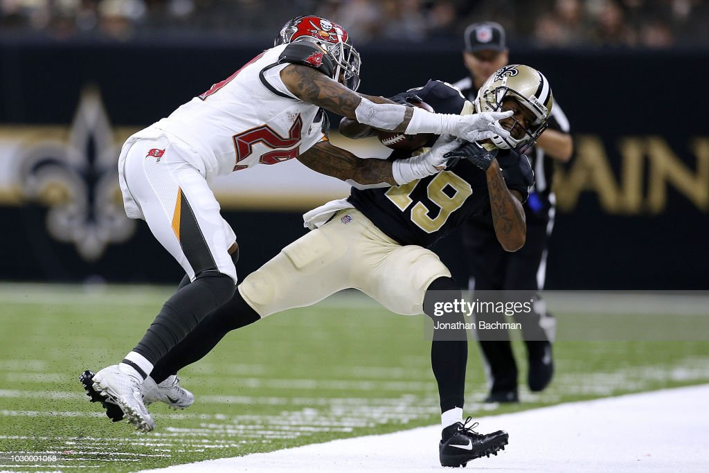 Ted Ginn #19 of the New Orleans Saints is pushed out of bounds by Ryan Smith #29 of the Tampa Bay Buccaneers during the second half at the Mercedes-Benz Superdome on September 9, 2018 in New Orleans, Louisiana.