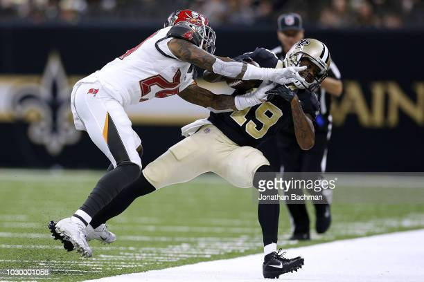 Ted Ginn of the New Orleans Saints is pushed out of bounds by Ryan Smith of the Tampa Bay Buccaneers during the second half at the MercedesBenz...