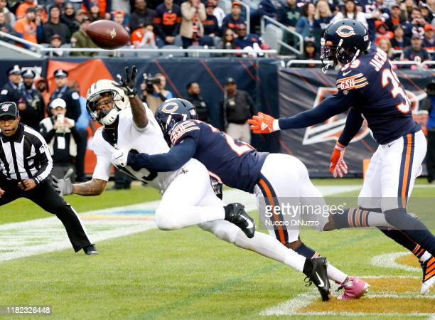 Ted Ginn of the New Orleans Saints is unable to make a catch in the end zone while pressured by Prince Amukamara of the Chicago Bears during the...