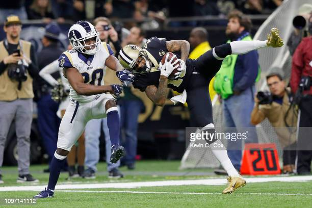 Ted Ginn of the New Orleans Saints makes a 43-yard catch against Lamarcus Joyner of the Los Angeles Rams in the fourth quarter in the NFC...
