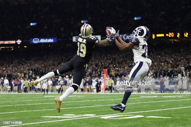 Ted Ginn of the New Orleans Saints makes a 43yard catch against Lamarcus Joyner of the Los Angeles Rams in the fourth quarter in the NFC Championship...