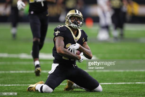 Ted Ginn of the New Orleans Saints reacts after making a 43yard catch against the Los Angeles Rams in the fourth quarter in the NFC Championship game...