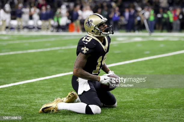 Ted Ginn of the New Orleans Saints reacts after making a 43yard catch against Lamarcus Joyner of the Los Angeles Rams in the fourth quarter in the...